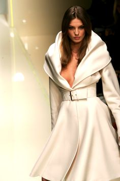 Versace..oh my goodness.  This is marshmallow creaminess in a coat!!  No.. maybe the bubbles to the champaign :)
