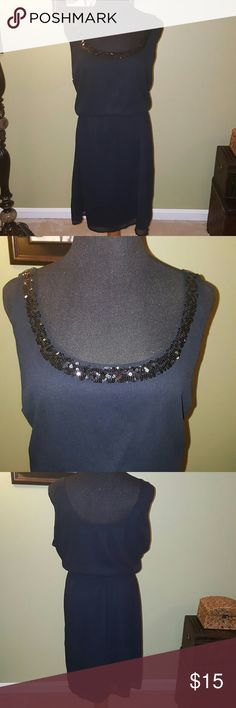 Black Sleeveless Dress Sequin neckline brings the blind in this lightweight dress. Elastic waistline and fully lined. Very cute! Excellent condition. Old Navy Dresses