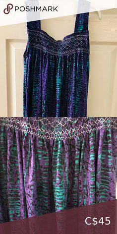 """Hand Smocked Cotton Jersey Gown New. Handmade. Hand smocked cotton jersey gown with pockets. Vibrant purple and turquoise blue colors made this gown perfect to wear as a dress, for lounging or sleeping. Full length (50"""" long). One size fits all (86"""" wide at bottom) Intimates & Sleepwear Turquoise Blue Color, Blue Colors, Cotton Gowns, Plaid Pajamas, Slip Skirts, Black Corset, Satin Slip, Purple Lace, Lace Back"""