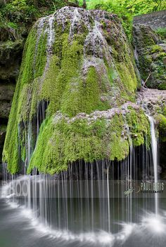 The water on this waterfall in Romania rolls off of a green carpet of moss that covers the rock formation — which results in a magically soft display, much unlike a roaring waterfalls. Who knew Mother Nature had so many tricks up her sleeve? Beautiful Waterfalls, Beautiful Landscapes, Beautiful Scenery Pictures, Beautiful Images, Cascade Falls, Waterfall Photo, Nature Landscape, Landscape Photos, Natural Wonders