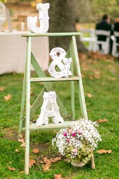 Wedding reception decor - wood initials on rustic ladder {Hannah Mink Photography}