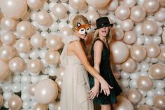 Giant Balloon Wall makes a great backdrop for the photo booth! The big round balloons make a 3-D effect.