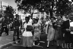 The picture is of Elizabeth Eckford as she tries to walk to school. The photo was taken by Will Counts, he wanted to show the way even students were mad that the school had blacks.