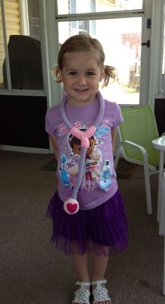 An adorable little girl wearing her Doc McStuffins crocheted (by me) stethoscope for her birthday party.