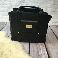 3.1 Phillip Lim For Target black bag In pretty good condition. A slight mark shown in the back, barely noticeable. Let me know if you need more details! 3.1 Phillip Lim for Target Bags