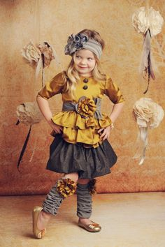 Oh my dear goodness.  This site has THE cutest clothes for little girls!