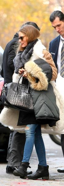 Who made  Olivia Palermo's black buckle ankle boots, print handbag, and blue ripped jeans that she wore in New York?