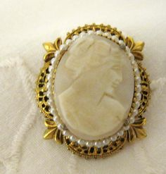 This beautiful carved white cameo is set in a stunning gold oval frame  .It is translucent when held up to light so I am assuming it is carved
