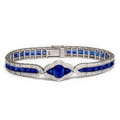 Platinum-set link bracelet composed of sapphires bordered with diamonds. Approximately 23 cts. By Charles Holl, a designer for Cartier, Paris. French, c. 1935.