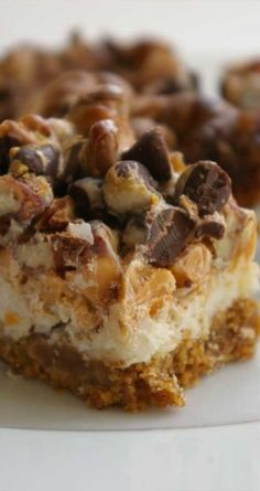 Recipe for Dolly Bars - Also known as Magic Bars or Seven Layer Cookies, these gooey, sweet treats combine all the good stuff: coconut, chocolate chips, pecans, and a graham cracker cookie base.