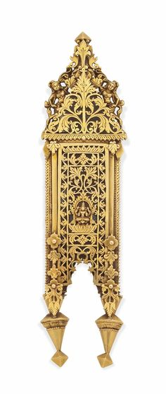A GOLD PENDANT (THALI) -  TAMIL NADU, SOUTH INDIA, LATE 19TH/EARLY 20TH CENTURY. The central element of a marriage necklace (kazhutthuru), of elongated shape with spherical and cylindrical elements to the centre beneath a stylised two-fold umbrella, the reverse with the goddess Lakshmi on a lotiform throne against a floriated ground, the upper panel with a flower spray flanked by two mythical female beings