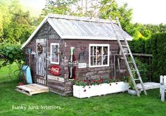 Once a greenhouse, now a wood shed / character building! The outside was built from reclaimed fencing boards. LOTS of photos - by Funky Junk Interiors