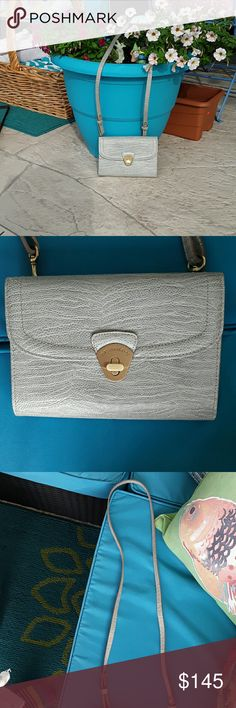 BRAHMIN CROSSBODY Euc gray/ green color 8 x 6 strap about 24 in. Beautiful bag like a snake fabric instead of the croc.gold hardware clean inside and out,lots ocarina slots inside,zipper center,4 separations inside 2 inside pushes have credit card slots (16) has an outside slot too. Brahmin Bags Crossbody Bags