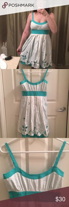 New with Tags Guess Dress New w tags Guess dress. Never worn. In great condition, just needs to be ironed. Size is 5 equivalent to a 2. Perfect for the spring and summer! Guess Dresses Midi