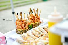 Grilled prawn skewers on pineapple. Very summer dish. Awesome idea for your wedding or any event. #fiestacreativecatering #wedding #catering