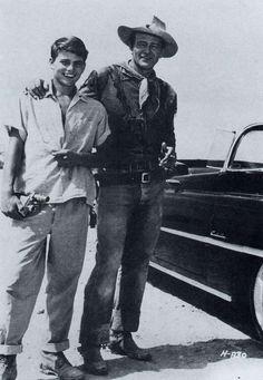 John Wayne with his son on the set of Hondo.