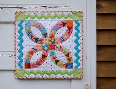 DQS12 Done! by RhubarbPatch, via Flickr I love the flying geese inside the wedding ring and the giant ric rac.