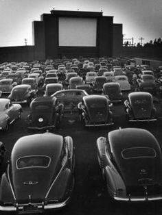 Drive-in movies.  They always showed double features, with a couple of cartoons between...intermission.  Kuds would mess around at the playground under the screen.