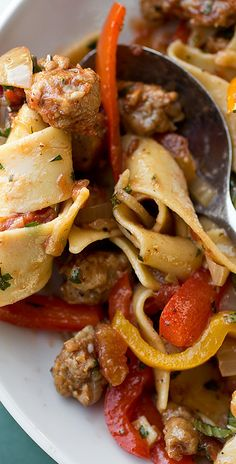 "Italian ""Drunken"" Noodles with Spicy Italian Sausage, Bell Peppers, and Fresh Basil..."