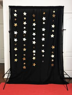 Red carpet and star photo backdrop for an awards show party. Throw a fabulous Oscar party! Click or visit FabEveryday.com for tips on food, decor, and activities for throwing an easy (but fab) Academy Awards watching party. Including a free printable Oscars voting ballot!
