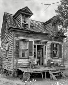 "Shorpy Historical Photo Archive :: Shaky Manor: 1936 This is the type of place that real estate companies list as a ""house with character"""
