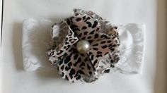 Headband/faixa de cabelo para bebê feito em tecido de algodão oncinha.  10% de desconto nesse valor caso o pagamento seja deposito em conta. R$ 18,00