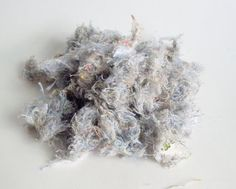 how to make own cotton filling to use in toys - instead of buying it ... will have to try this