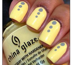 Yellow with grey dots mani