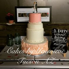 Coral and peachy pink colored wedding cake with texture and extended tier. Edible pearls and rowers.