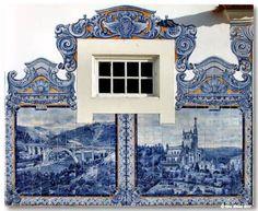 Tiny window with an azulejo frame Aveiro railways station - Portugal