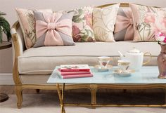 A Rosy Outlook - Abounding with feminine flourishes and muted tones, this lovely collection lends a touch of whimsy to any space. Ruffled curtains, richly textured bedding, and floral rugs invite garden-chic style into the master suite or guest room, while button-tufted chairs, classic settees, and charming pillows gracefully accent the den or parlor.