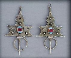 "Africa | Antique pair of Berber silver Fibulae from Central Anti-Atlas, in South Morocco. Early 20th century. Blue and Yellow enamel on very good alloy of silver. Great workmanship with the technique ""du ver"", that offer a great transparent effect. 