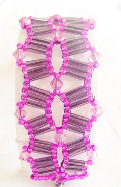 Fuchsia and purple safari bracelet by Hellenna on Etsy, £25.00