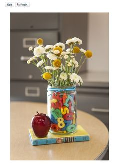 This flower arrangement is too cute! My kids may have to bring this to their teachers on the first day of school someday! ; )