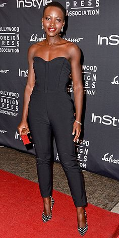 Lupita Nyong'o's 15 Best Looks (So Far) | 9. TORONTO INTERNATIONAL FILM FESTIVAL HFPA/INSTYLE PARTY | In a sweetheart-neckline Veronica Beard jumpsuit with polka-dot Paul Andrew heels and a golden Calvin Klein Collection clutch