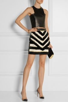 Black leather top and embellished leather mini by Balmain