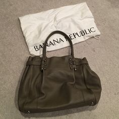 Banana Republic leather handbag Milk chocolate leather shoulder bag, BR monogrammed interior lining, zippered interior pocket, open interior pocket, white dust cover. Excellent condition, lightly used/carried. Banana Republic Bags Shoulder Bags