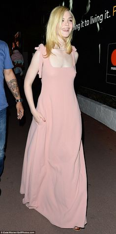 Beaming Elle Fanning is caught off guard at Cannes Film Festival #dailymail