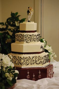 Hexagon Wedding Cake with black scrollwork - toptierweddingcakes.com