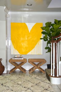 INSTEAD OF PAINTING A LARGE WALL YELLOW DO SOME SIMPLE, BUT BEAUTIFUL ARTWORK