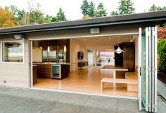 Innis Arden Residence - Build LLC - Shoreline, WA - Features LaCantina Aluminum Bifold Doors - #InnisArden #Residence #BuildLLC #Shoreline #WA #LaCantina #Aluminum #Bifold #Doors #LiveTheLaCantinaLife #OpenSpaces #Outdoor #Indoor #Experience #Sleek #Design #Kitchen #Modern #Contemporary #PhotoOfTheDay #Stunning #View #Sky #Remodel #Home #Custom