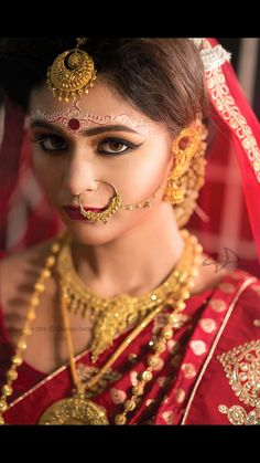 Bengali bridal makeup - Explore the art of bengali alpana patterns, Bengali chandan designs & forehead art with amazing Bengali makeup looks of