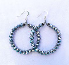 A personal favorite from my Etsy shop https://www.etsy.com/listing/466818493/silver-metallic-crystal-hoop-earrings