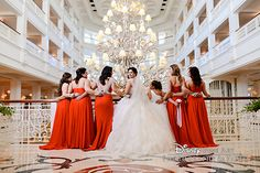 Bridal party in red at Disney's Grand Floridian