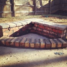 With a few left over bricks and a patio corner build a fire pit.