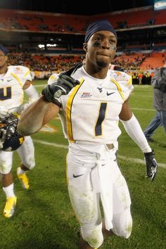 MIAMI GARDENS, FL - JANUARY 04:  Tavon Austin #1 of the West Virginia Mountaineers celebrates West Virginia's 70-33 win against the Clemson Tigers during the Discover Orange Bowl at Sun Life Stadium on January 4, 2012 in Miami Gardens, Florida.  (Photo by Streeter Lecka/Getty Images)