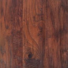 <p>This Americano Hickory Handscraped Laminate is 12mm and has a lifetime residential/ 5 year commercial warranty.</p><p>The AC rating of laminate flooring measures its durability, on a scale of 1-5, with 5 being the most durable. This product has an AC rating of 4, meaning it can be used in homes or commercial buildings with moderate foot traffic, such as a small office or shop.</p><p>Looking for the warmth and beauty of hardwood flooring at an affordable price? Then laminat...