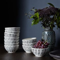 Black and white prints. These Mid-Century Stamp Bowls are hand stamped with four separate patterns and just the right size to serve up anything, from cereal to soup. Set of 4.