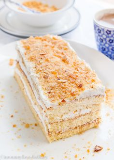 Honey Sponge Cake with Lemon and Almond Praline – Three layers of moist sponge cake with a lightly lemon buttercream frosting, sprinkled with almond praline… You've officially reached cake heaven! mommyhoodsdiary.com
