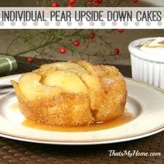 Individual Pear Upside Down Cakes with caramelized pears and vanilla cake, topped with whipped cream.